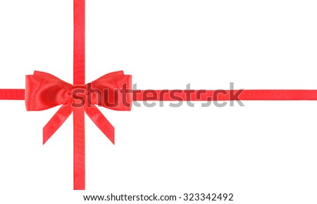 one red satin bow in middle left and two intersecting ribbons isolated on horizontal white background