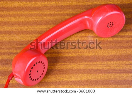 one red telephone a over wood background - stock photo