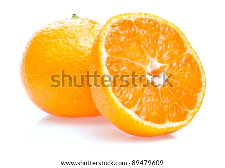 One ripe juicy tangerine and half isolated on white background - stock photo