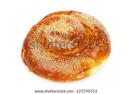 One round sabbath challah with many white seeds isolated on white background - stock photo