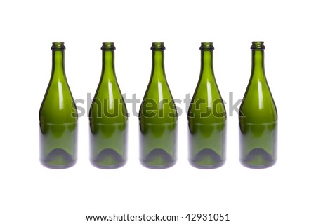 One row from empty champagne bottles on white isolated