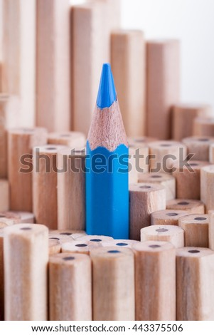 One sharpened blue pencil among many ones - stock photo