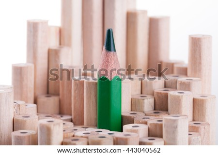 One sharpened green pencil among many ones - stock photo