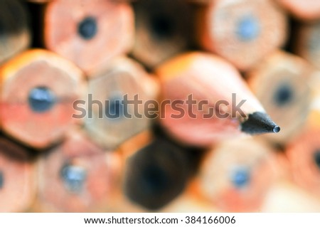 One sharpened pencil among many not sharp.Background is blurred. - stock photo