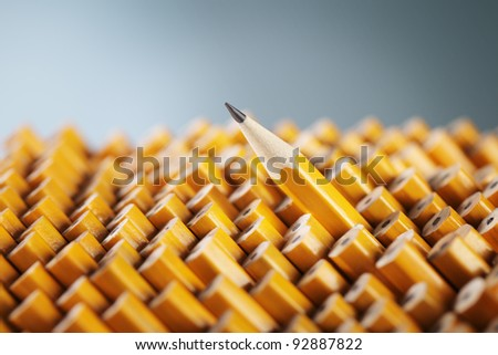 One sharpened pencil standing out from the blunt ones. - stock photo