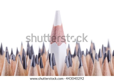 One sharpened white pencil among many ones - stock photo