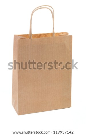 One simple brown paper shopping bag isolated on white background - stock photo