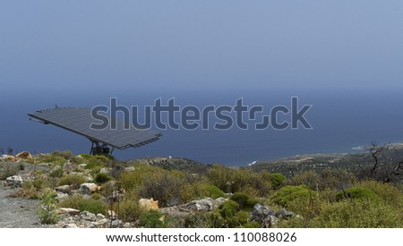 One solar battery panel on the mountain steep in Greece - stock photo