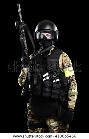 one soldier holding assault rifle ak-74. Uniform conforms to special services FSB (soldiers) of the Russian Federation. Shot in studio. Isolated with clipping path on grey background - stock photo