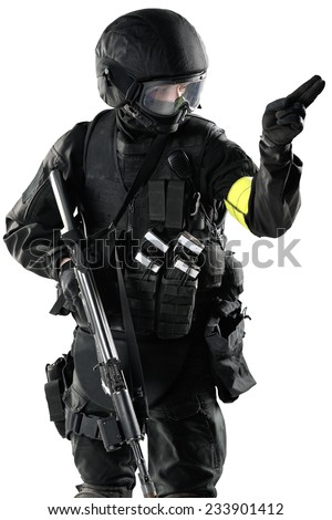 one soldier shows a hand signal and hold in another hand assault rifle ak-74. Uniform conforms to special services FSB (soldiers) of the Russian Federation. Shot in studio. Isolated with clipping path - stock photo