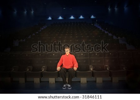 one spectator in a cinema