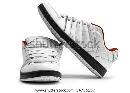 One steam of white trainers on white background - stock photo