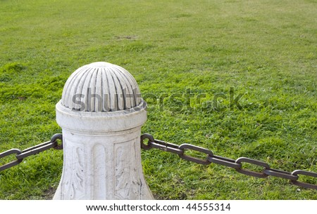One stone pillar with the grass for the background - stock photo