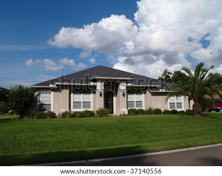 One story Florida home with a stucco facade. - stock photo