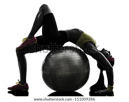 one  supple woman exercising fitness workout on fitness ball in silhouette  on white background - stock photo