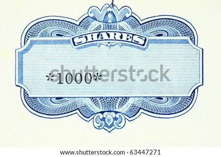 One thousand shares - close up of a vintage stock market object. Obsolete corporate shares certificate. - stock photo