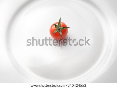 one tomato - stock photo