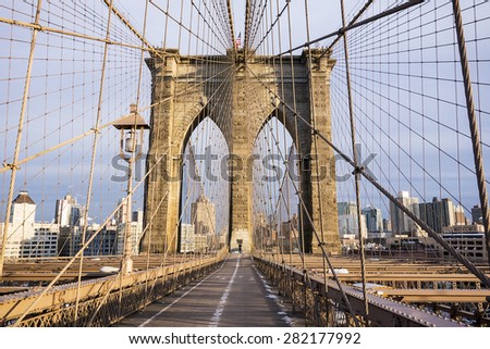 One tower of the Brooklyn Bridge and the pedestrian walkway on a crisp, cold day in February in New York City.
