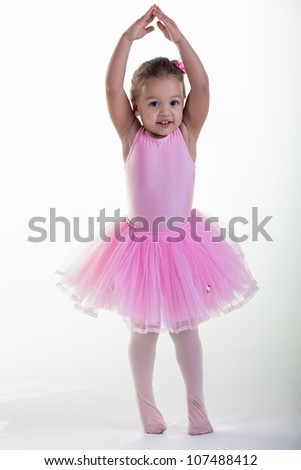 One, two, three and up she goes on the toes. - stock photo