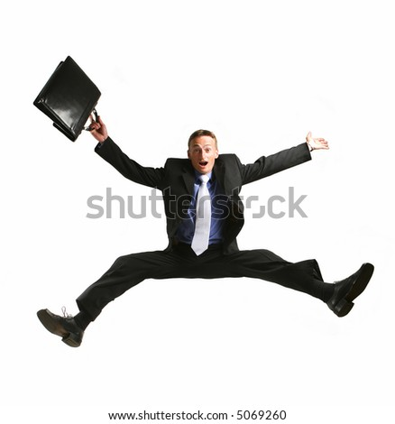 One very happy energetic businessman jumping into the air - stock photo