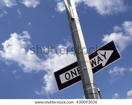 one way road sign on the utility pole - stock photo