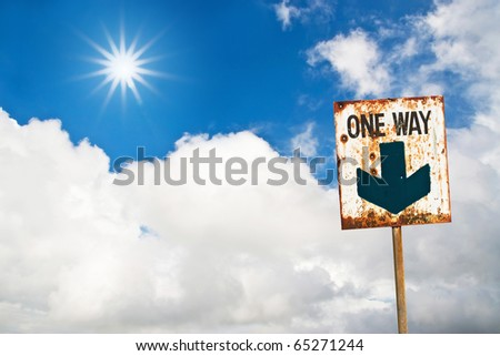 one way sign on sun cloud sky - stock photo