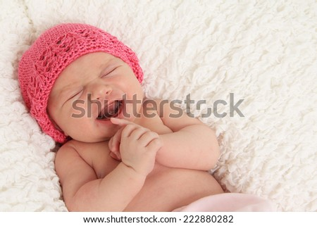 One week old newborn baby girl crying.  - stock photo