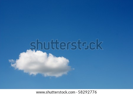 One white cloud in the blue sky - stock photo