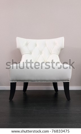 One white leather comfortable armchair - stock photo
