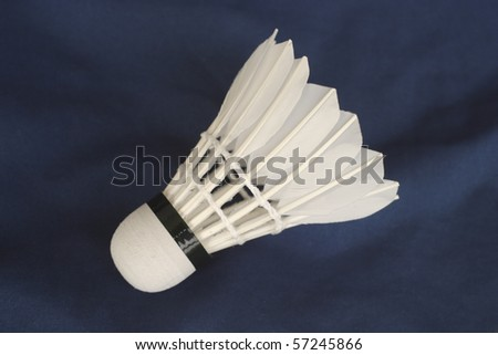 One white shuttlecock on a blue background - stock photo