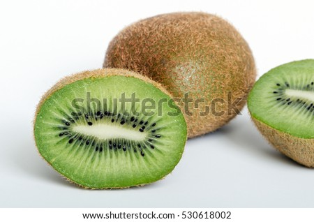 One Whole Kiwi and One Halved to See the Inside