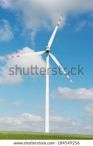One windmill power generator over summer day background.
