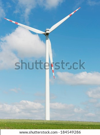 One windmill power generator over summer day background. - stock photo