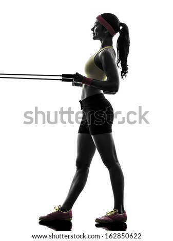 one  woman exercising fitness workout resistance bands in silhouette  on white background - stock photo