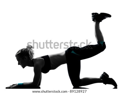 one woman exercising workout fitness aerobic exercise legs feet up posture on studio isolated white background - stock photo