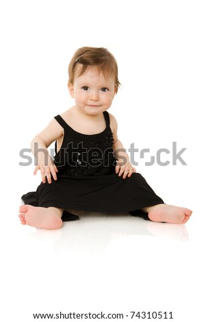 One year baby girl wearing black evening dress isolated on white - stock photo