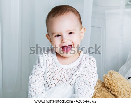 one year old baby in bed at home - stock photo