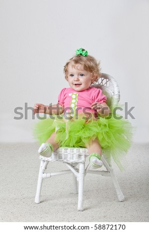 One year old baby wearing pink and green. - stock photo