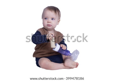 One year old boy with an asthma inhalator - stock photo