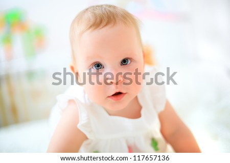 one years old baby girl on a light background