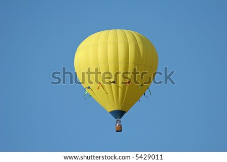 one yellow hot air balloon in the sky - stock photo