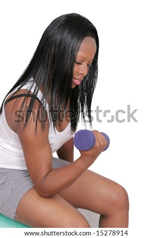 one young African American woman lifting weights over white - stock photo