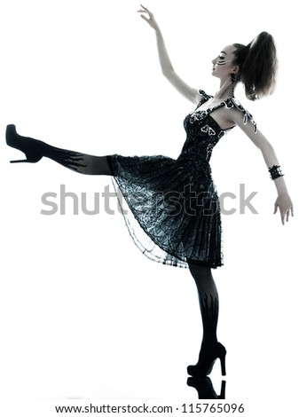 one young beautiful woman fashion model in on aura tout vu silk black fantasy haute couture summer dress in studio white background - stock photo