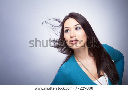 One young beautiful woman with hair in motion
