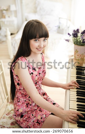 one young girl at the piano - stock photo