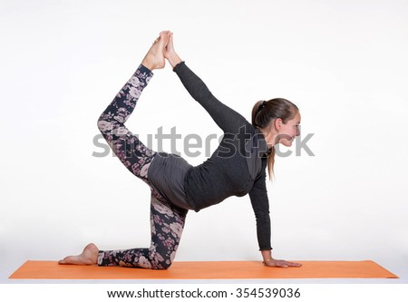 One young healthy sporty caucasian woman exercising yoga on studio background. - stock photo