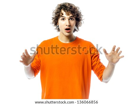 one young man caucasian gesturing surprised portrait  in studio white background