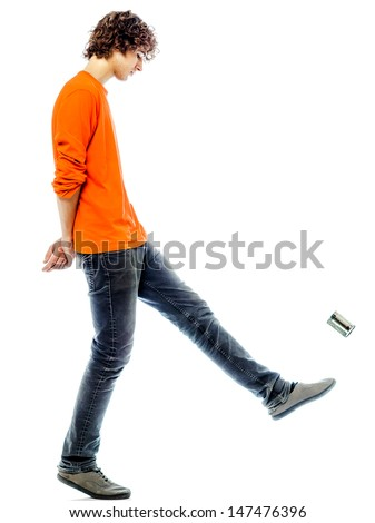 one young man caucasian kicking tin can sad bore side view   in studio white background - stock photo