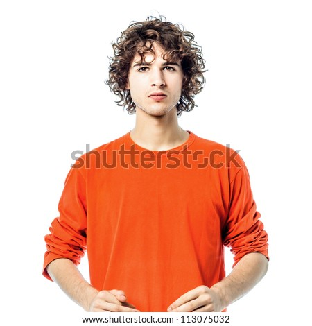 one young man caucasian  serious looking at camera  portrait  in studio white background - stock photo