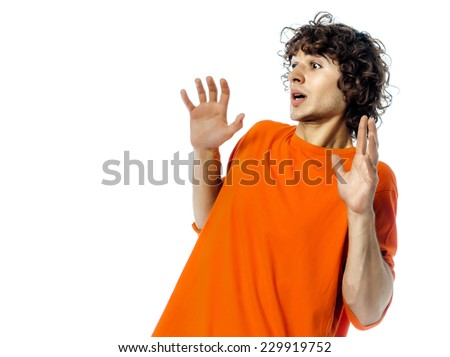one young man  gesturing surprised fear afraid portrait in studio white background - stock photo